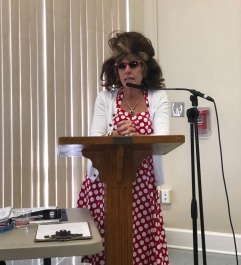 Second VP Danette Pugh get serious announcing SLG's May luncheon theme -- SLG 8o Decades