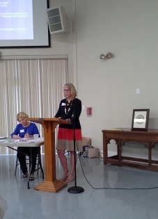 Wilma Shackelford gives her report at May general meeting